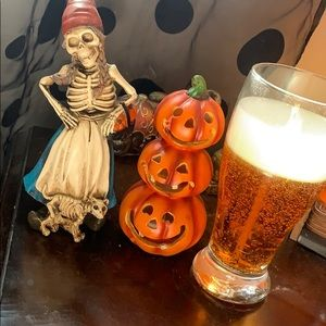 Two Halloween statues and a beer candle
